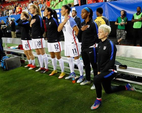 Megan Rapinoe kneels.jpg