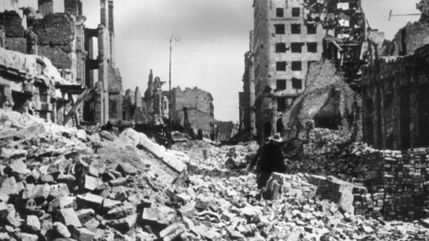 A view of rubble and ruined buildings covering the streets after the German bombing of Warsaw, Poland.jpg