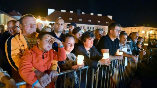 People held candles to mark the occasion at the ceremony in Wielun.jpg